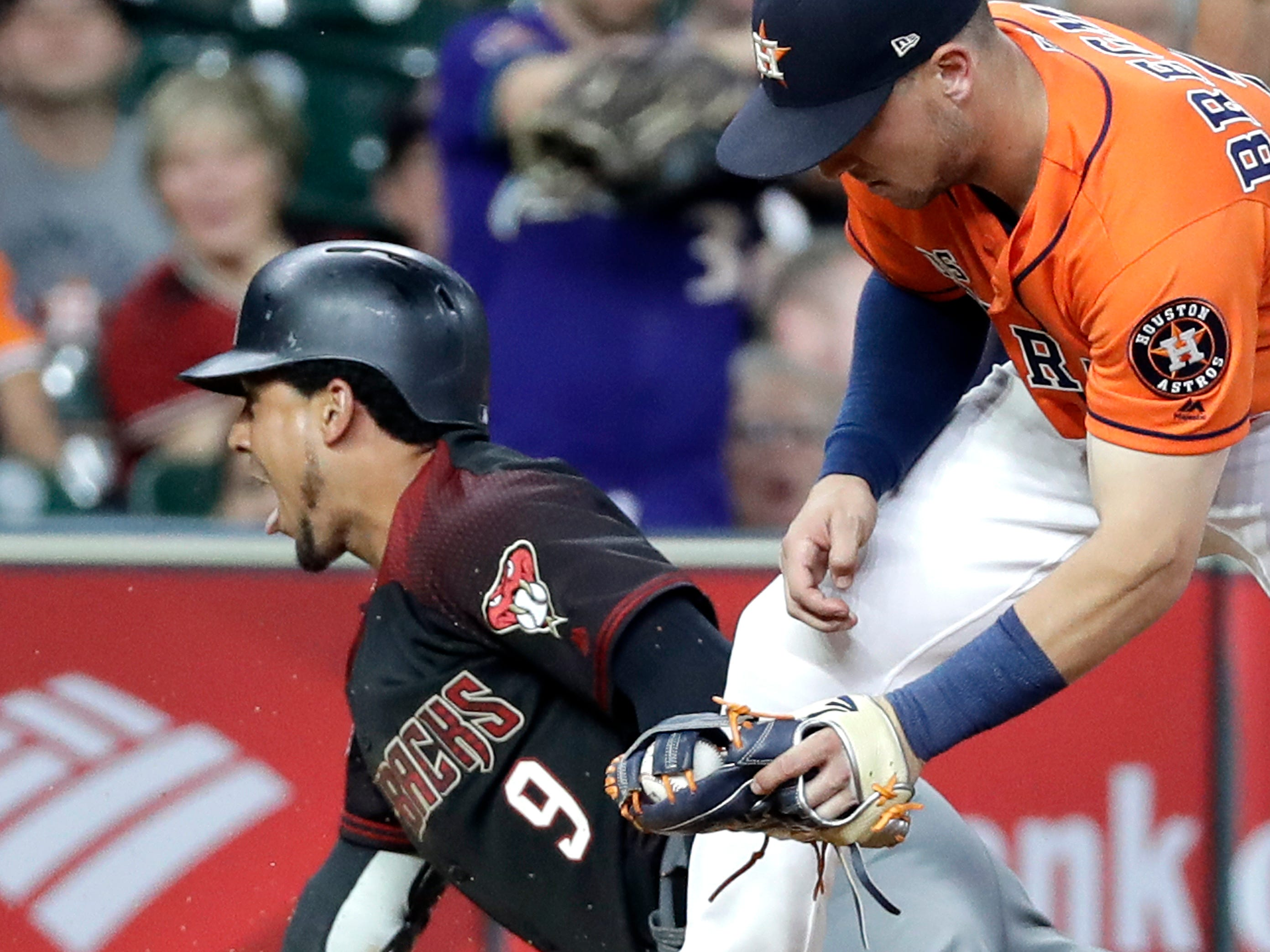Arizona Diamondbacks' Jon Jay (9) slides safely into third after hitting an RBI triple as Houston Astros third baseman Alex Bregman reaches to tag him during the eighth inning of a baseball game Friday, Sept. 14, 2018, in Houston. (AP Photo/David J. Phillip)