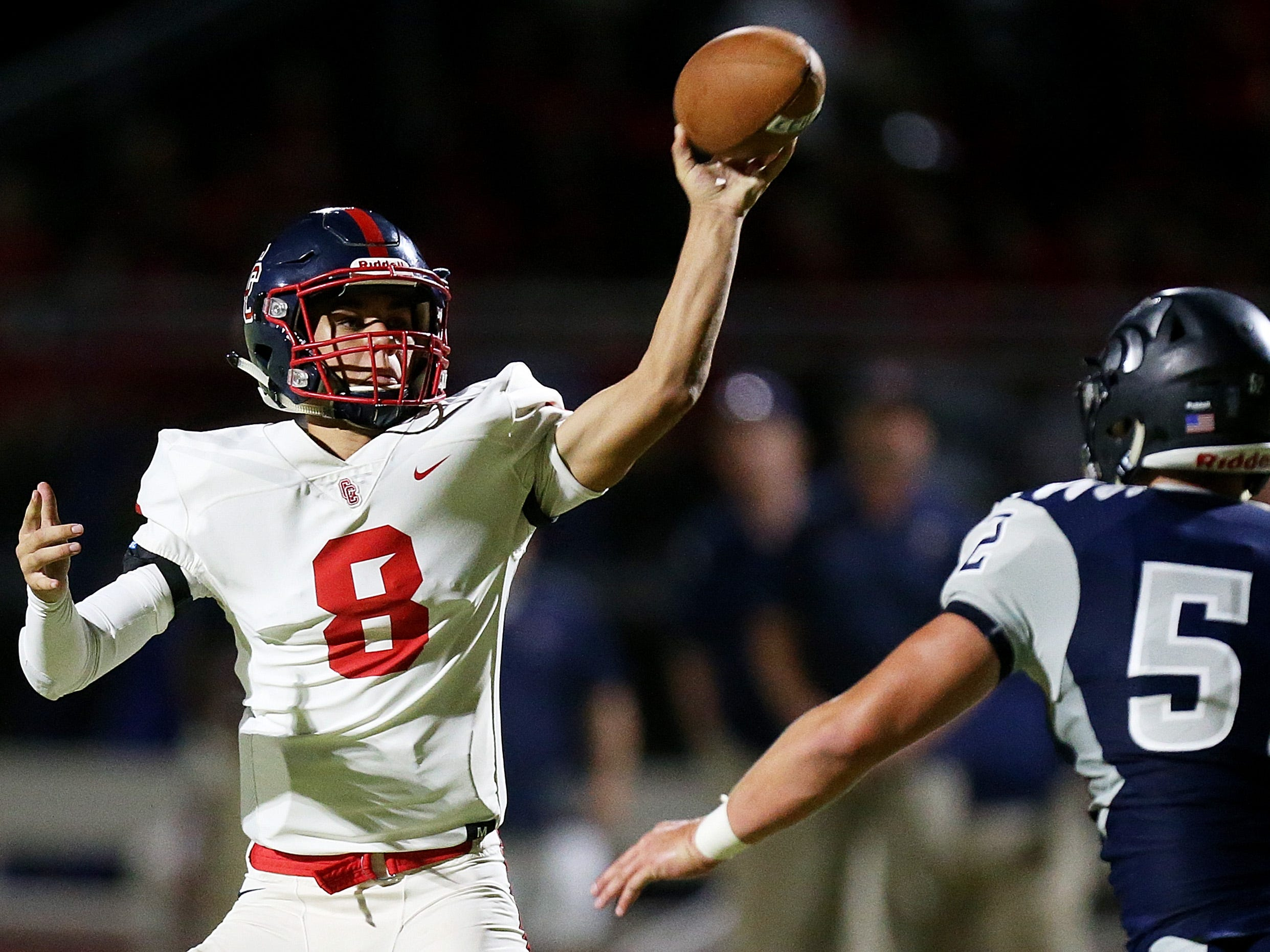 Peoria Centennial quarterback Jonathan Morris (8) dumps a pass over Ironwood Ridge's Justin McGrath (52) during the second quarter of the Ironwood Ridge vs. Peoria Centennial high school football game at Ironwood Ridge High School, 2475 W. Naranja Drive, on Sept. 14, 2018, in Oro Valley, Ariz. Centennial won 55-7.