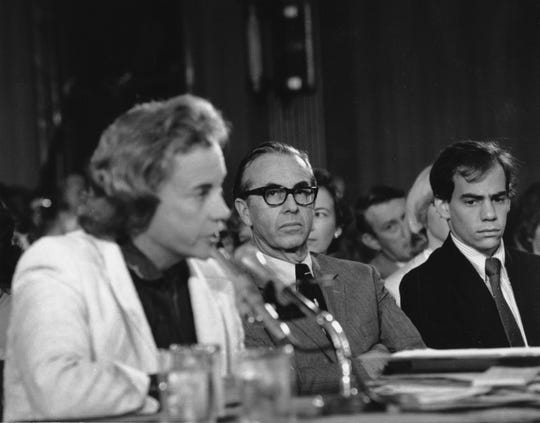 Supreme Court nominee Sandra Day O'Connor is seen speaking at her confirmation hearing before the Senate Judiciary Committee on Sept. 10, 1981, in Capitol Hill. Looking on is her husband John J. O'Connor.