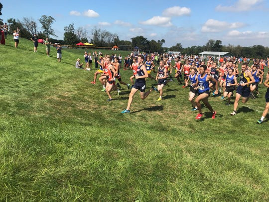 Boys competitors in the Lebanon County Cross Country Championships head away from the starting line to begin the race.