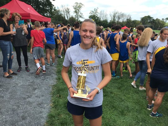 Elco's Lily Brubaker with her championship trophy.