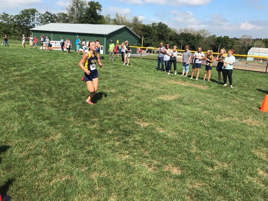 Elco's Lily Brubaker won her second Lebanon County cross country title on Saturday at Gloninger Woods Park, cruising to victory by 57 seconds over her nearest competitor.