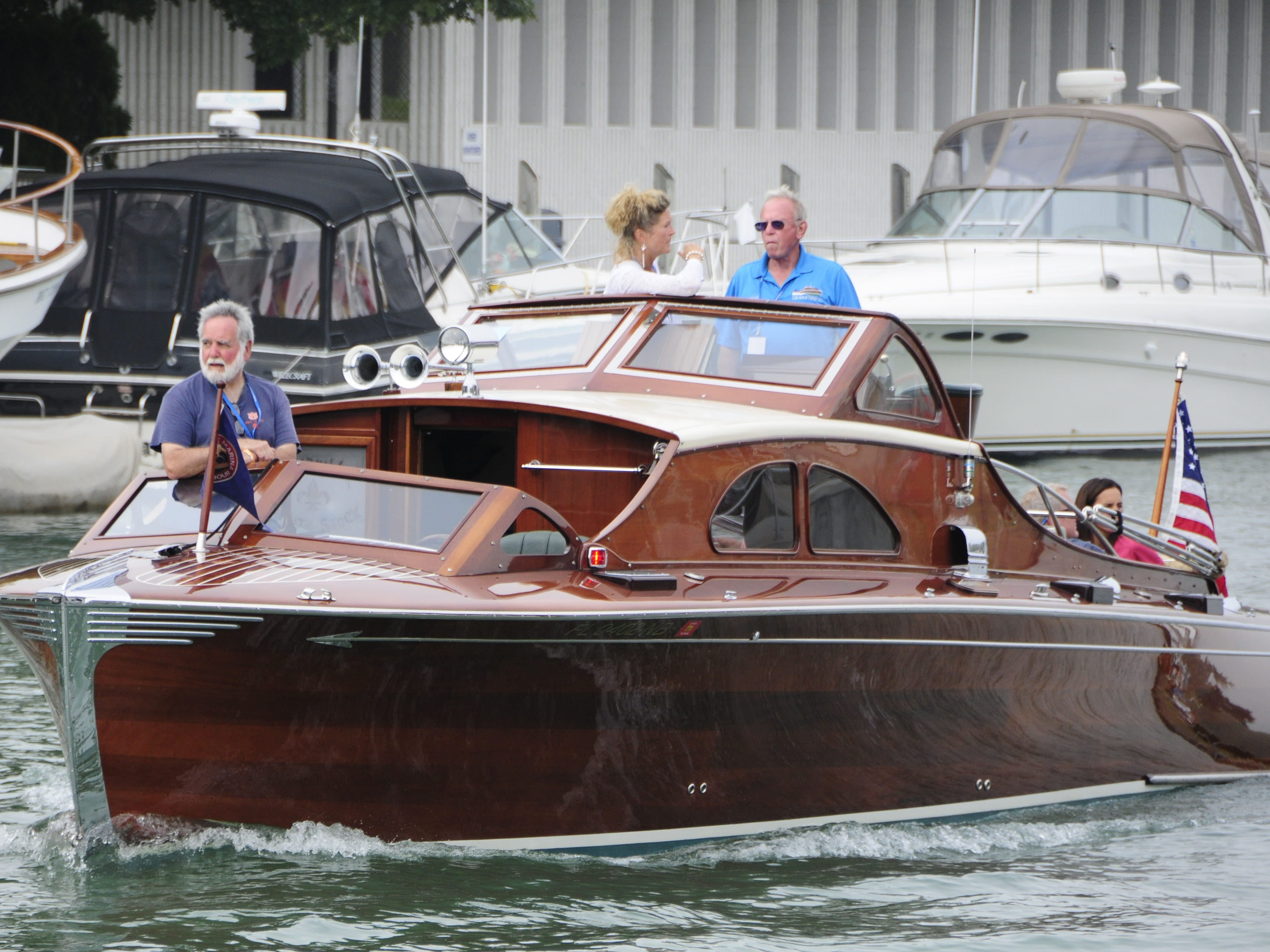 The Rumrunner motors down the Black River during the Antique and Classic Boat Society International Boat Show on Saturday, Sept. 15, 2018.