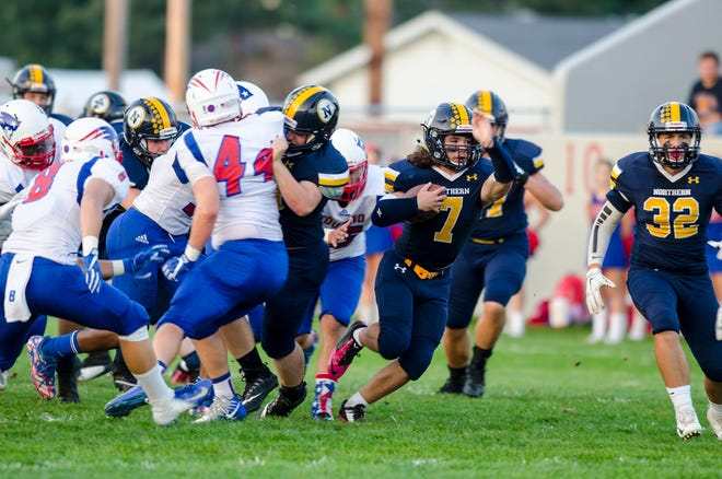 Port Huron Northern High School running back Theo Ellis (7) breaks through with the football Friday, Sept. 14, 2018 during their game against Warren Cousino High School at Memorial Stadium.