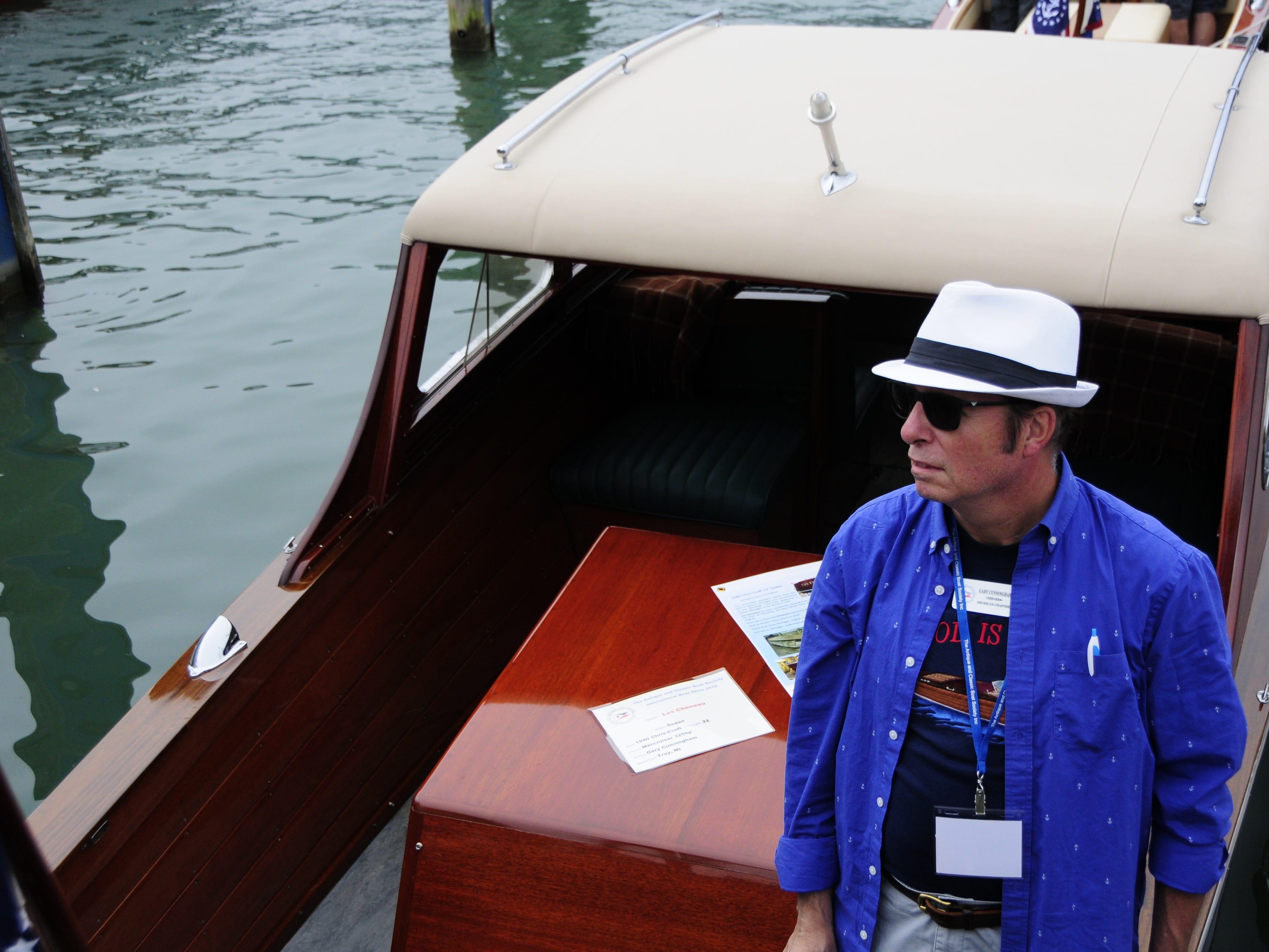 Gary Cunningham. of Troy, stands aboard a 19450 Chris-Craft sedan during the Antique and Classic Boat Society International Boat Show on Saturday, Sept. 15, 2018.