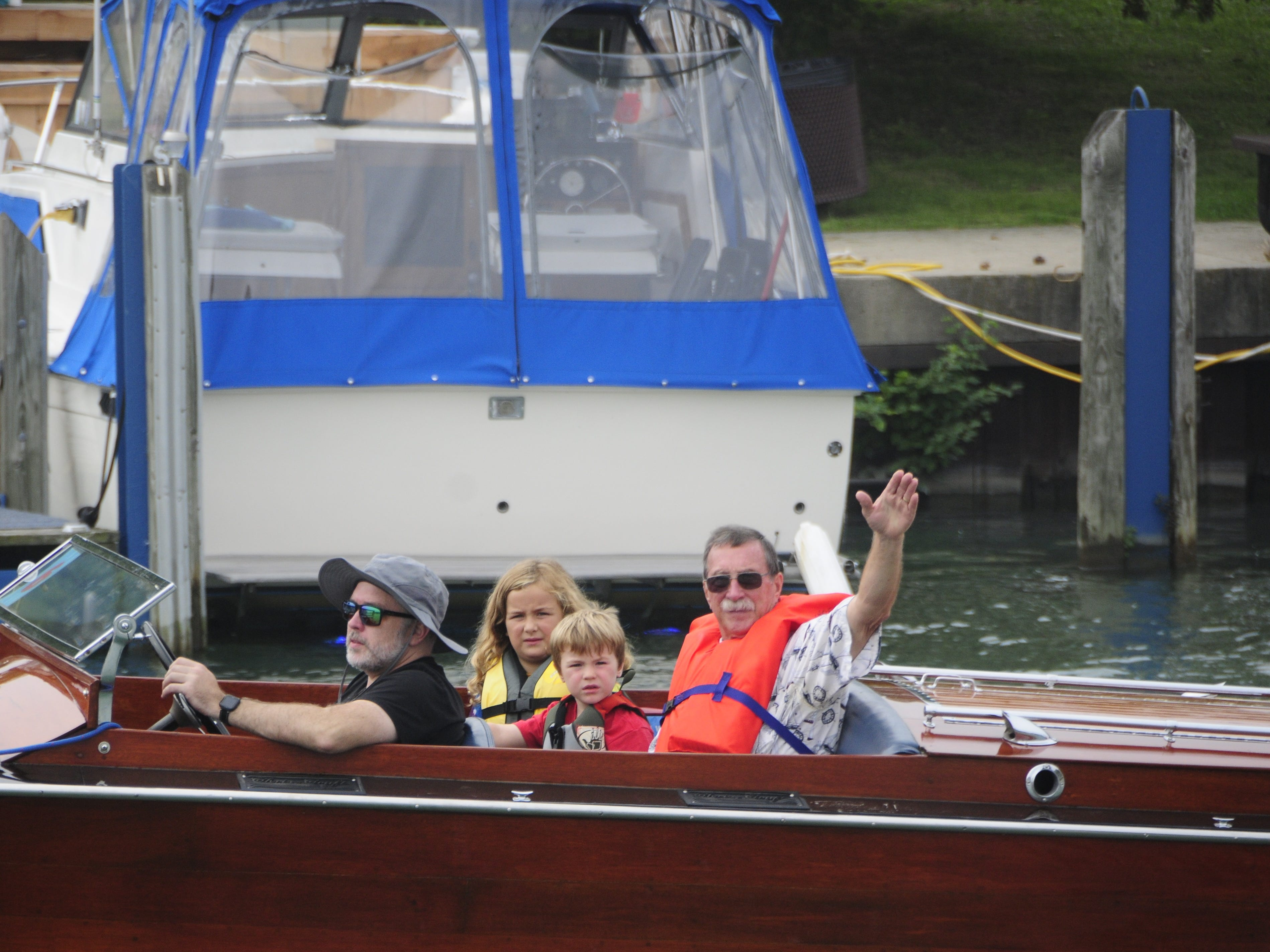 People aboard the Wave Trotter wave during the Antique and Classic Boat Society International Boat Show on Saturday, Sept. 15, 2018.