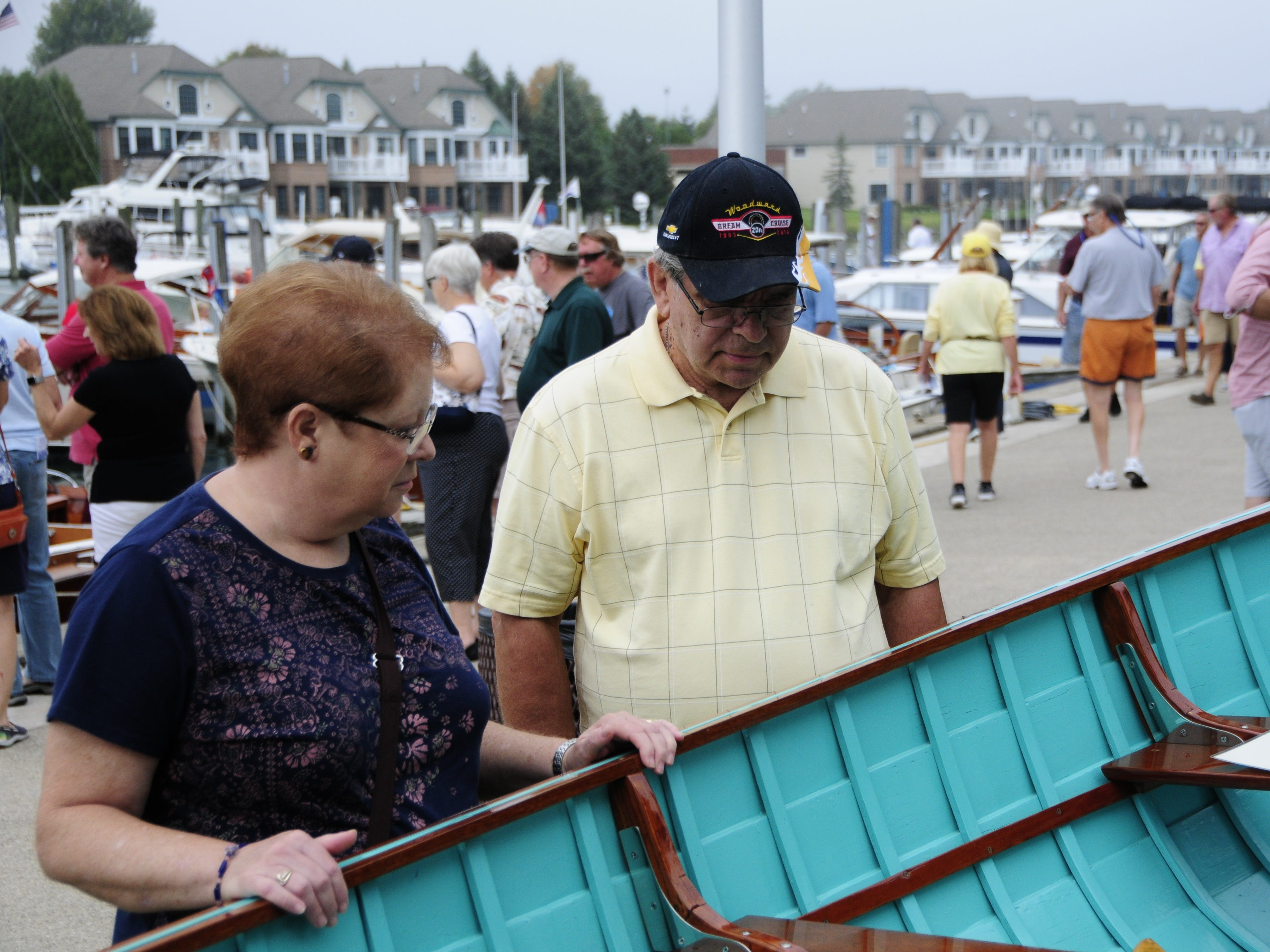 Glenda and Larry Day look at a 1956 Lyman lapstrake utility boat during the Antique and Classic Boat Society International Boat Show on Saturday, Sept. 15, 2018.