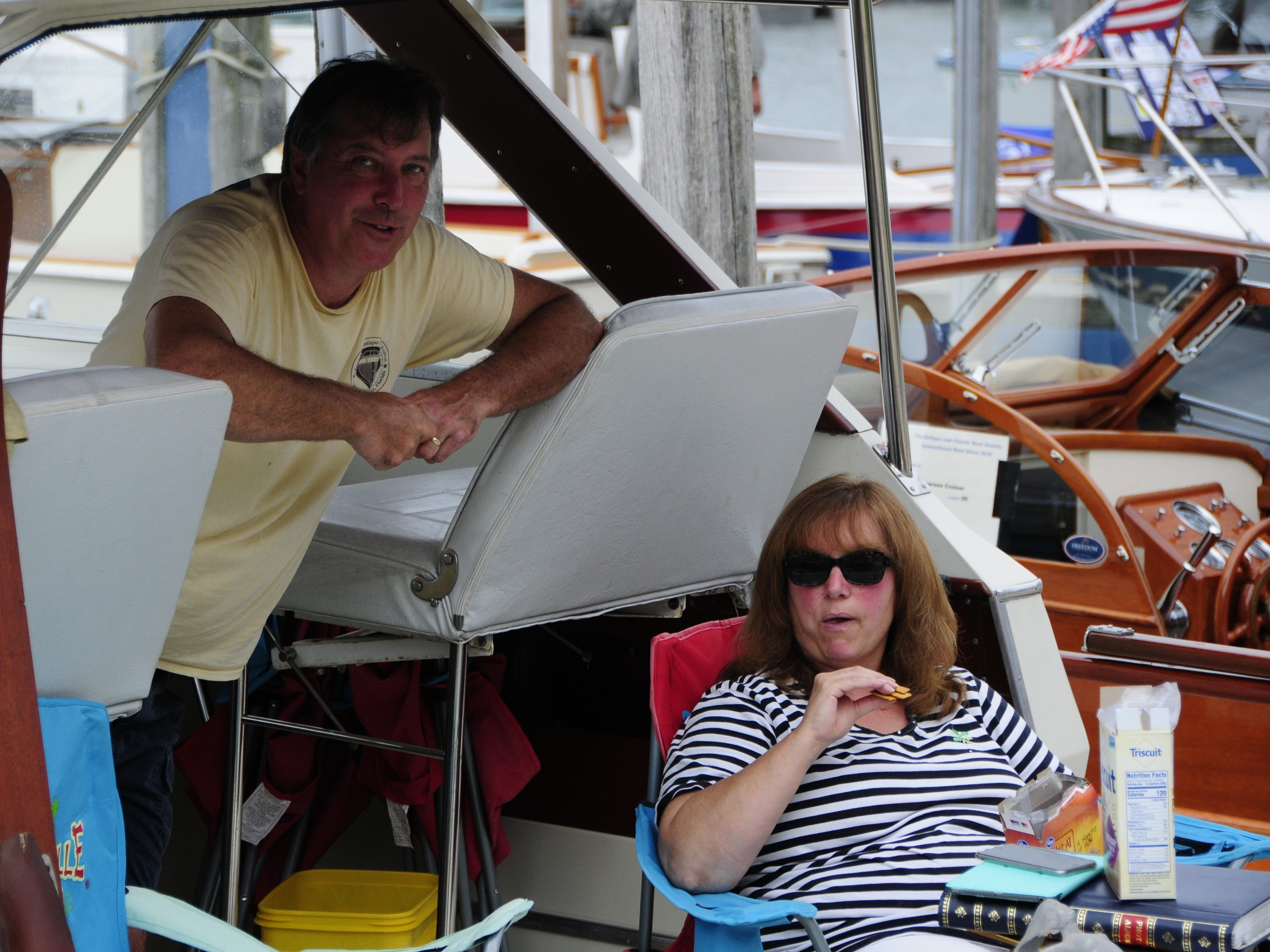 Michael and Chris Flood relax during the Antique and Classic Boat Society International Boat Show on Saturday, Sept. 15, 2018.