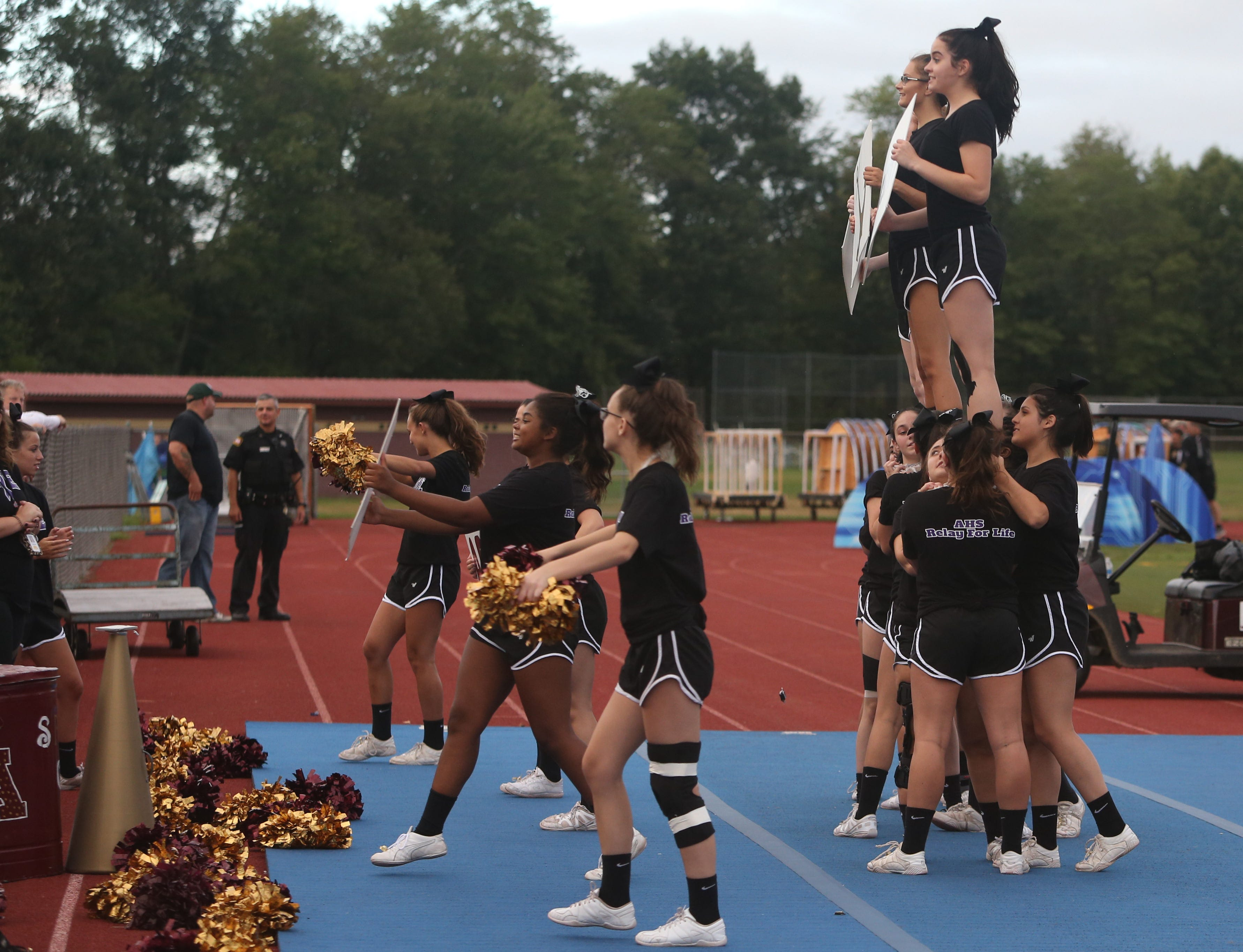 Arlington's cheerleaders perform during Friday's game between Arlington and John Jay in Freedom Plains on Sept 14, 2018.