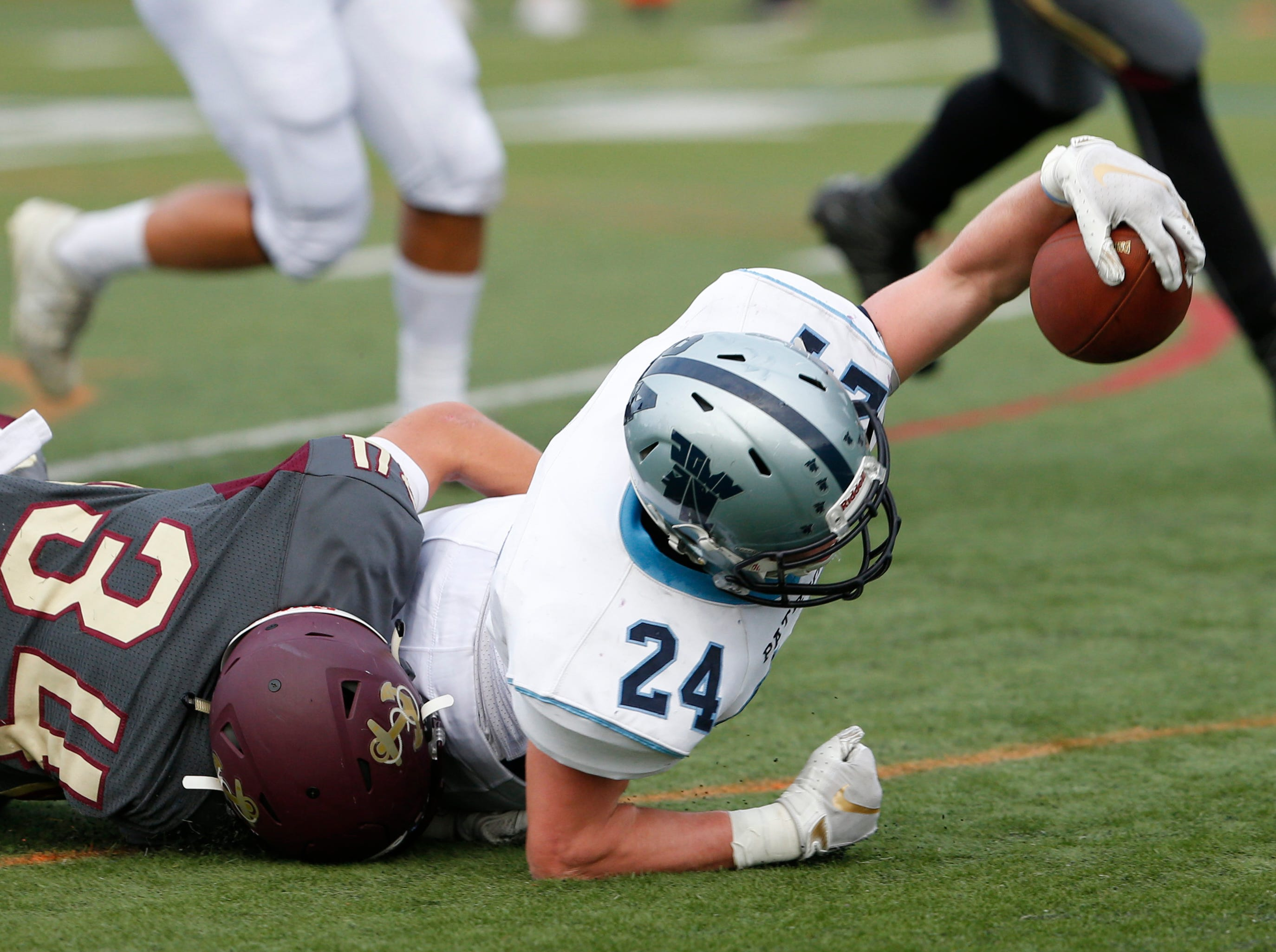 Arlington's Louis Mezzone tackles John Jay's Evan Mullaly as he tries to get every inch out of his rush during Friday's game in Freedom Plains Sept 14, 2018.