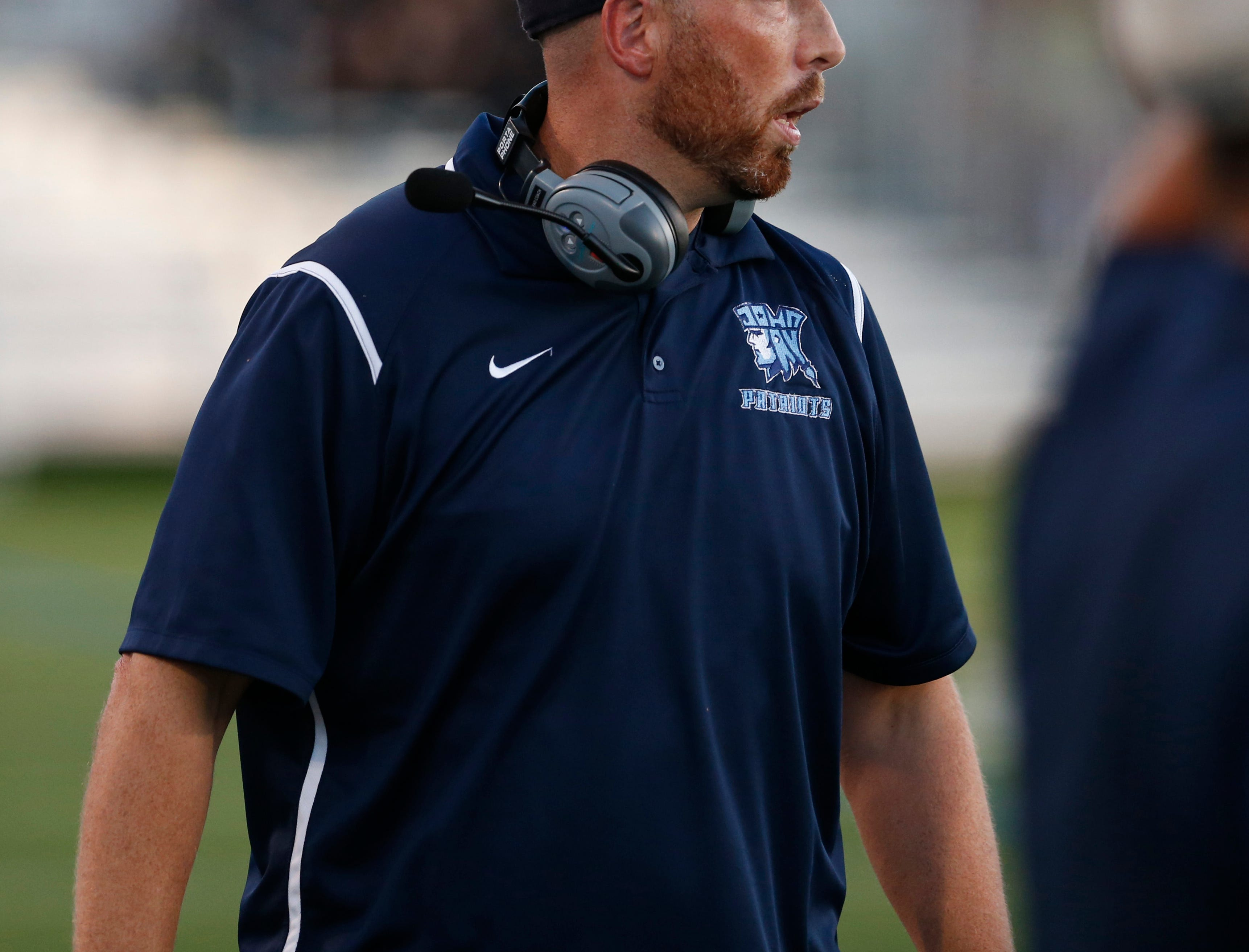 John Jay football coach Tom O'Hare walks the sidelines during a Sept. 14 game against Arlington.