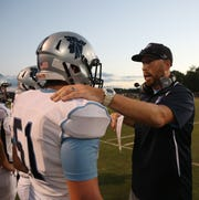 John Jay football coach Tom O'Hare gives instructions to lineman Patrick Whelan during a Sept. 14 game against Arlington.