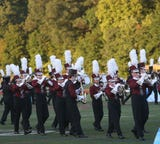 The Arlington High School marching band and color guard shined during halftime of Arlington's football game against rival John Jay.