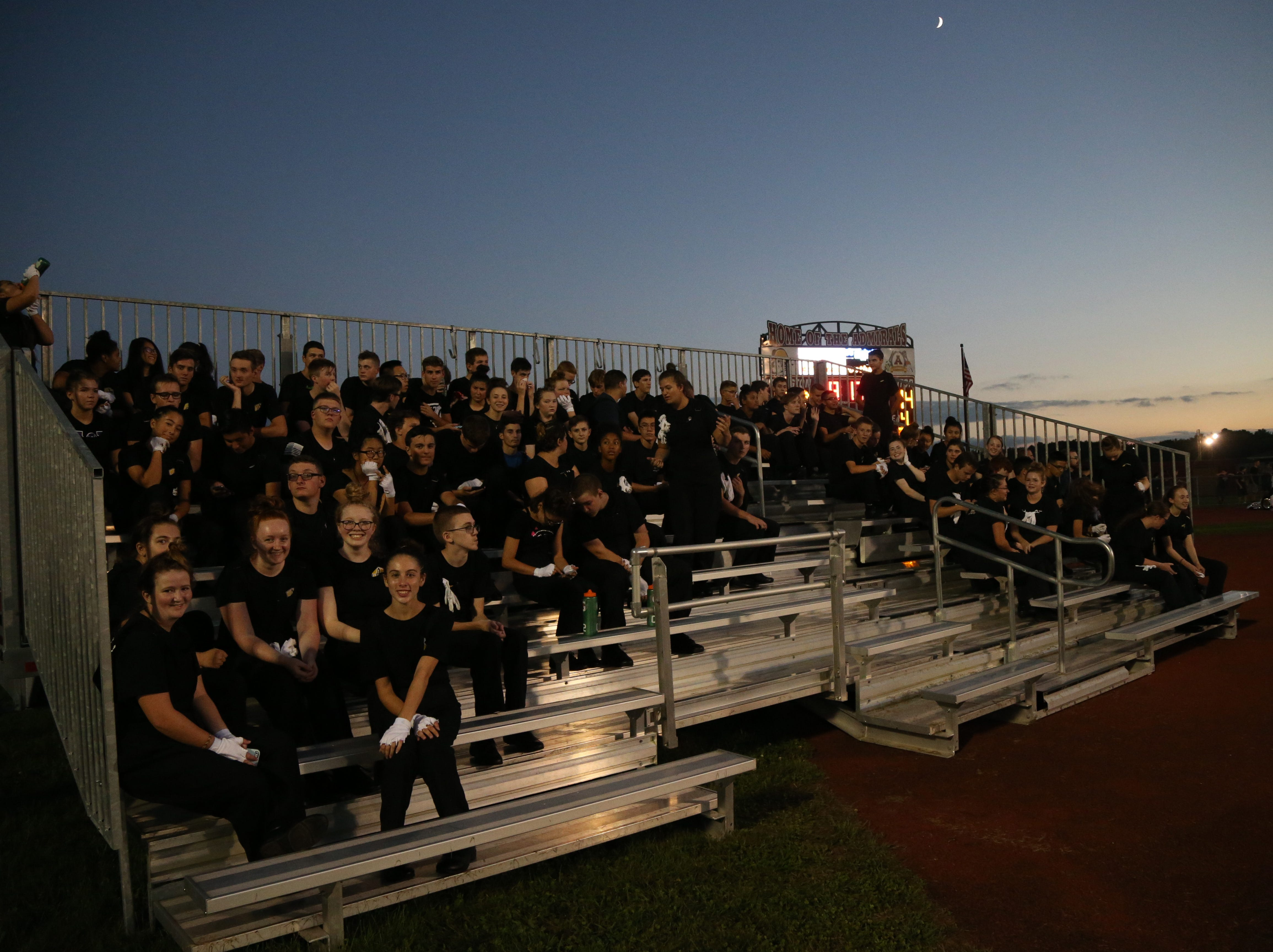 Arlington's marching band rest on the bleacher after performing at Friday's game between Arlington and John Jay in Freedom Plains on Sept 14, 2018.