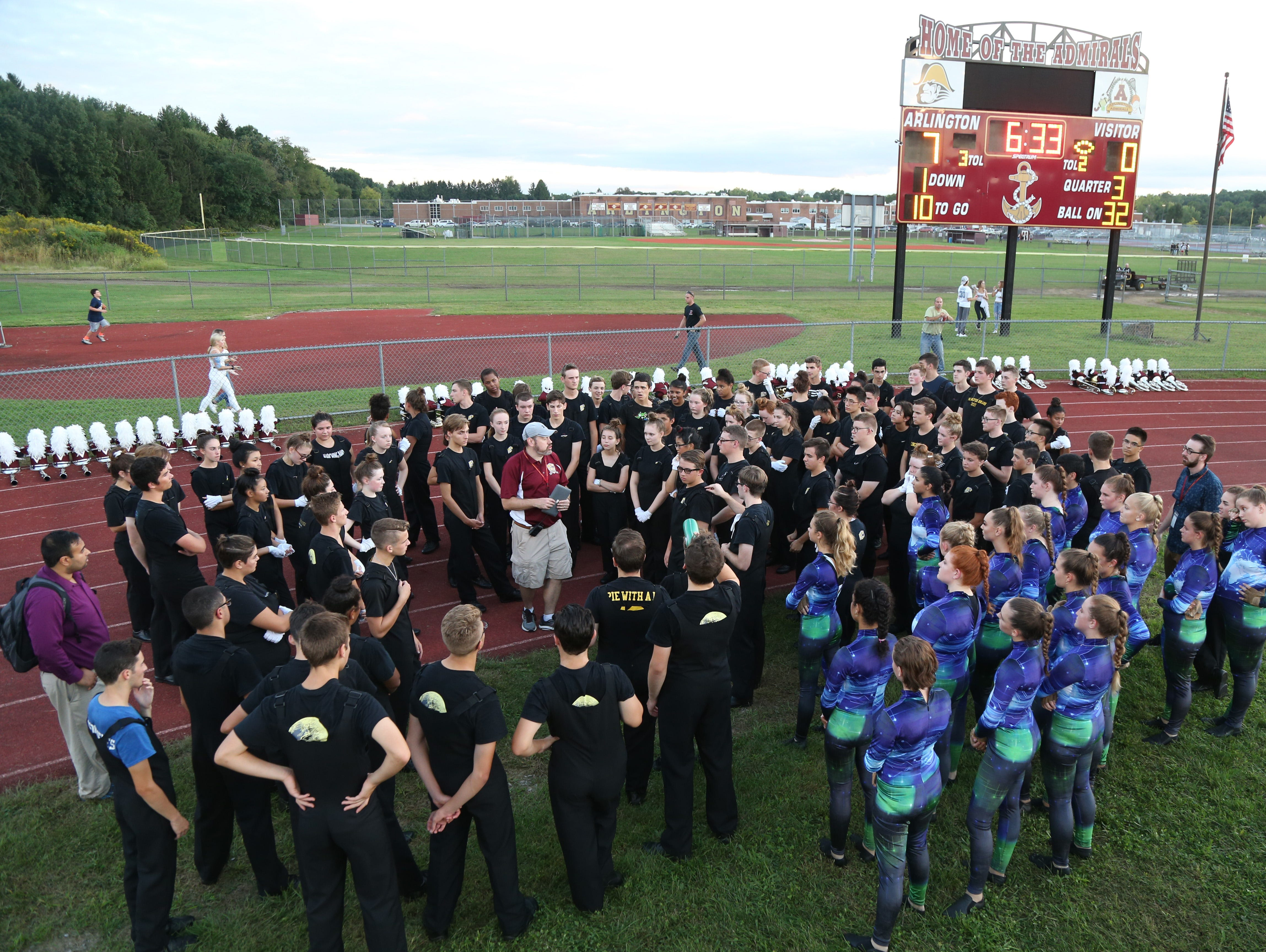 Arlington's marching band director Darrell Keech speaks to the band after performing at Friday's game between Arlington and John Jay in Freedom Plains on Sept 14, 2018.