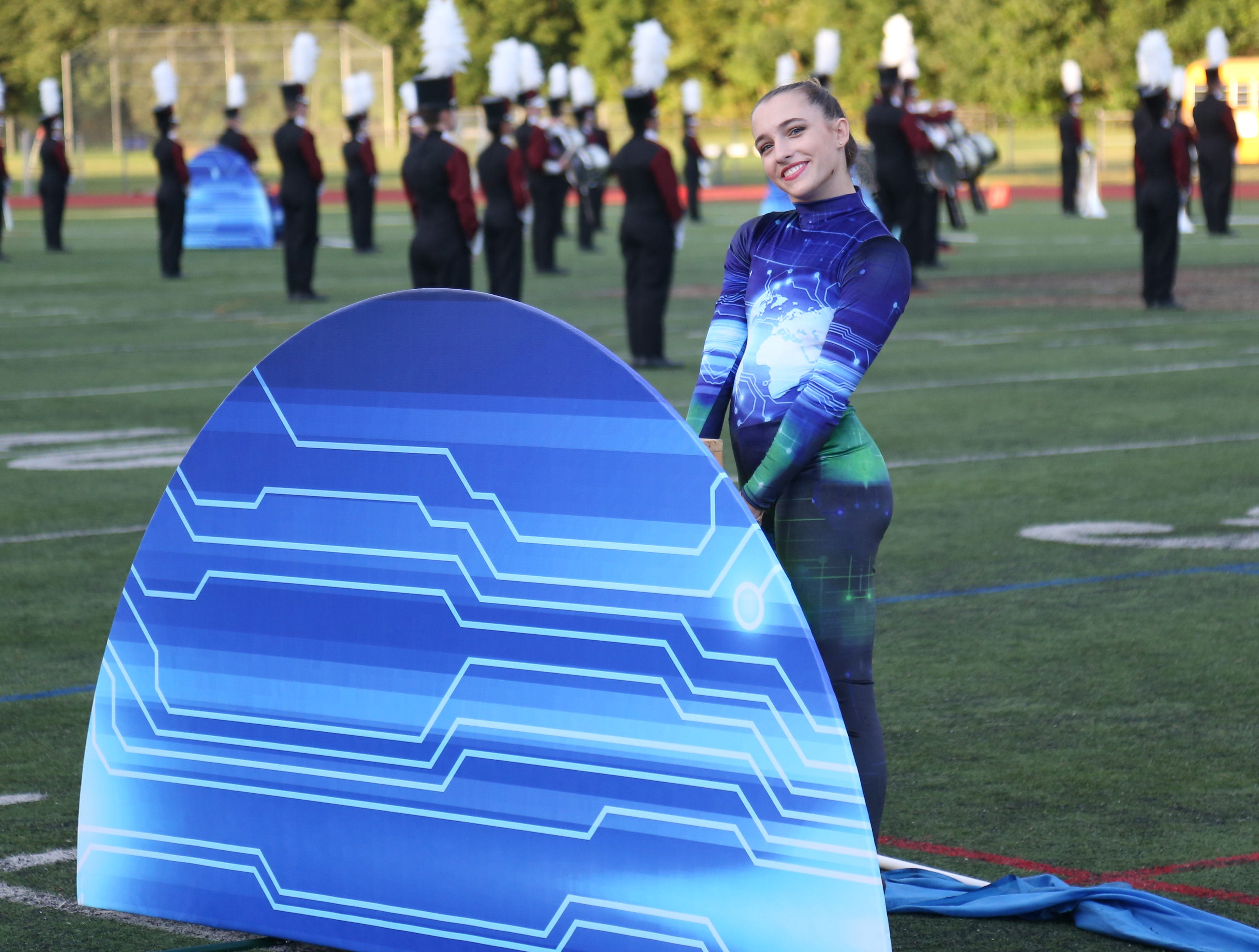Arlington's color guard and marching band perform during Friday's game between Arlington and John Jay in Freedom Plains on Sept 14, 2018.