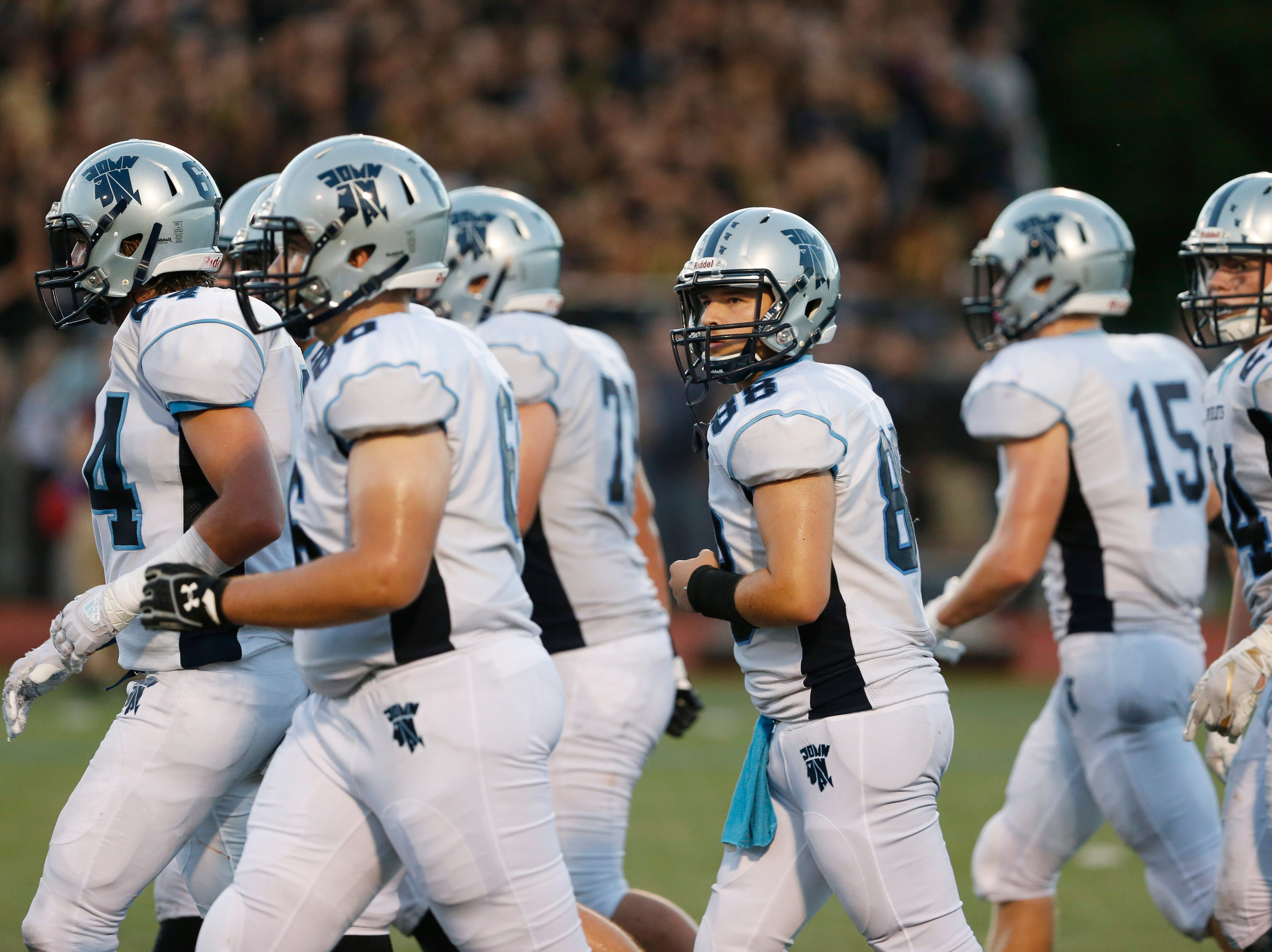 The John Jay offense breaks its huddle and walks to the line of scrimmage against Arlington during a Sept. 14 game.