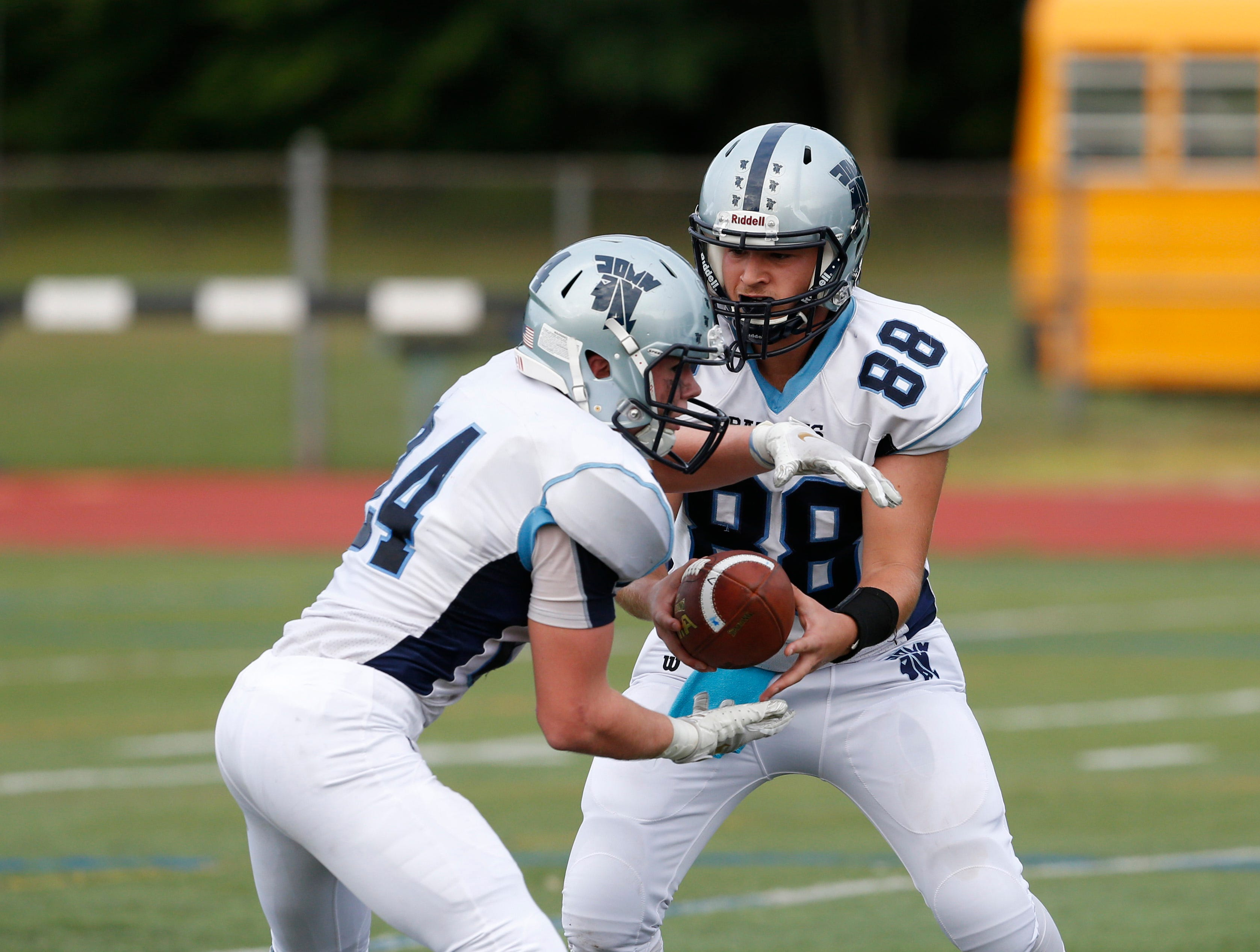 John Jay's Joseph Melici hands off the ball to Evan Mullaly during Friday's game versus Arlington in Freedom Plains Sept 14, 2018.