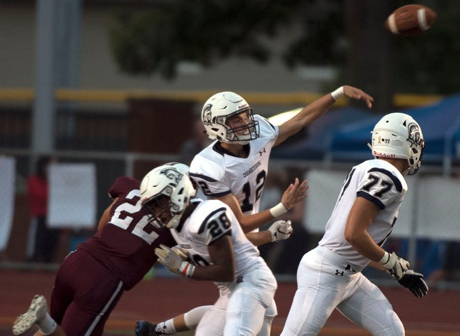 Brady Stumbaugh passes the ball during first quarter action against Altoona. Chambersburg defeated Altoona 48-28 in PIAA football to move to 4-0 on Friday, Sept. 14, 2018.