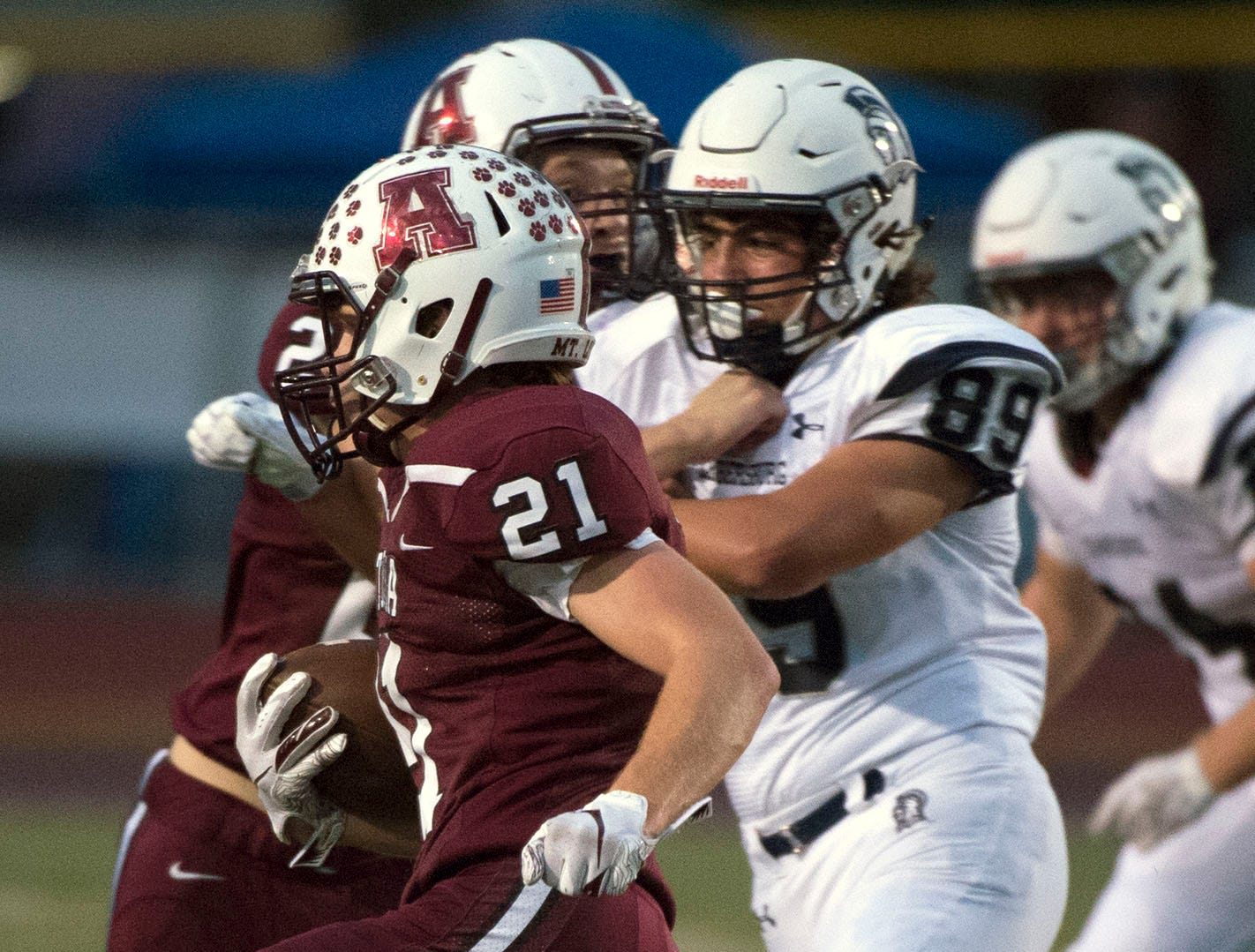 Altoona's Connor Adams (21) tries to get around Chambersburg's Carmen Pompeii (89). Chambersburg defeated Altoona 48-28 in PIAA football to move to 4-0 on Friday, Sept. 14, 2018.