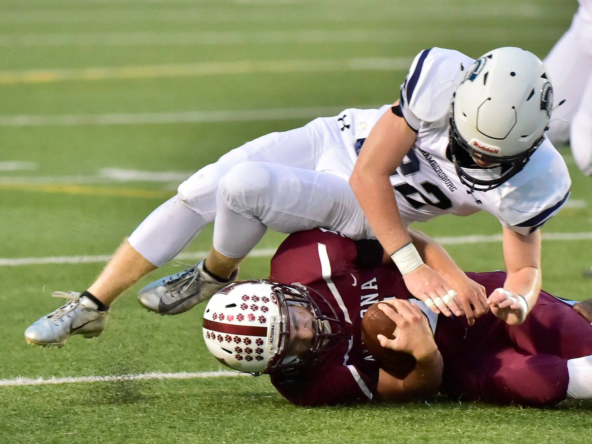 Chambersburg's Tucker Perry (22) makes a tackle on Altoona QB Conner McCarthy. Chambersburg defeated Altoona 48-28 in PIAA football to move to 4-0 on Friday, Sept. 14, 2018.