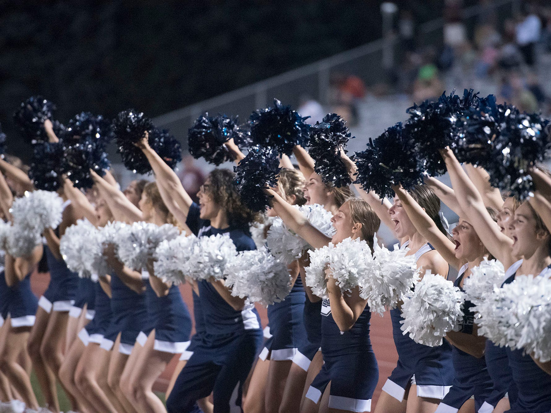 Cheerleaders celebrate a Trojan touchdown. Chambersburg defeated Altoona 48-28 in PIAA football to move to 4-0 on Friday, Sept. 14, 2018.