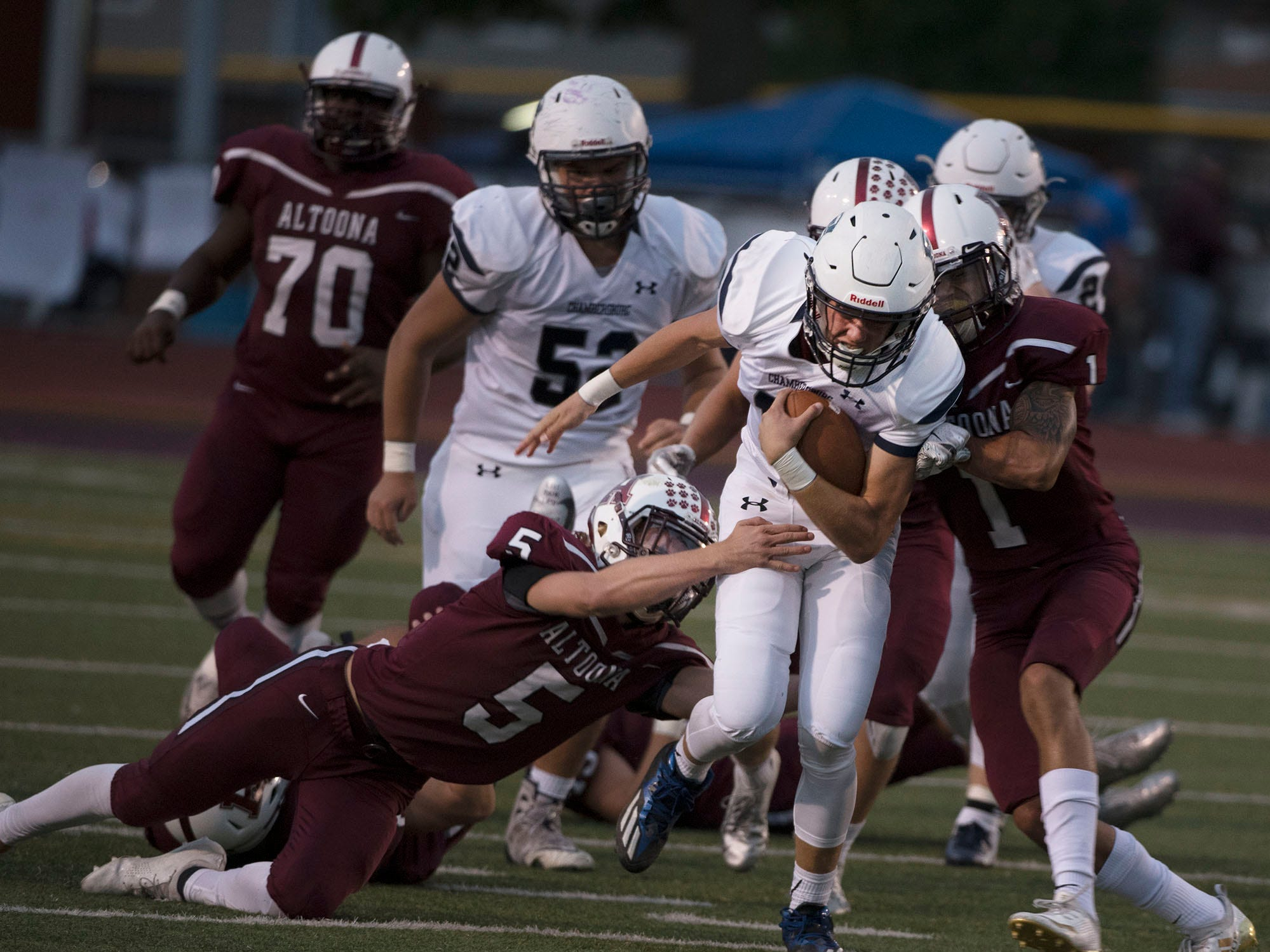 Chambersburg QB Brady Stumbaugh runs for a first down. Chambersburg defeated Altoona 48-28 in PIAA football to move to 4-0 on Friday, Sept. 14, 2018.