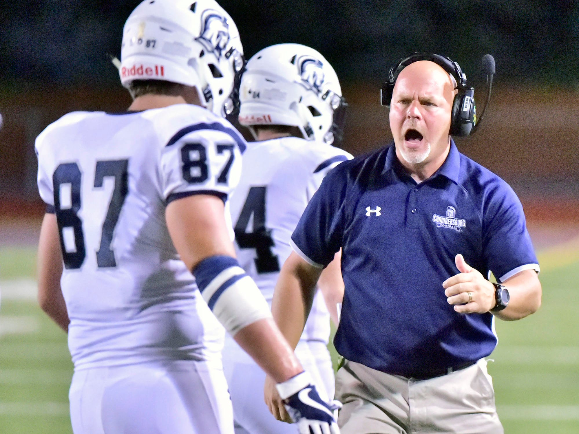 Coach Mark Luther celebrates after a Chambersburg score. Chambersburg defeated Altoona 48-28 in PIAA football to move to 4-0 on Friday, Sept. 14, 2018.