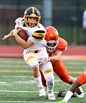 Red Lion running back Tyler Ness carries the ball against Central York last Friday. The Lions play South Western this week.