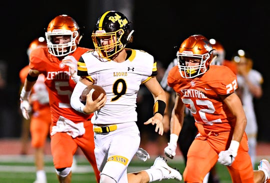 Red Lion's Nic Shultz runs away from Central York defenders in last year's contest between the Lions and the Panthers. Red Lion won the game, 56-28.