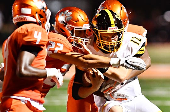 Red Lion's Zach Mentzer tries to break away from Central York tacklers at Central York High School in Springettsbury Township, Friday, Sept. 14, 2018. Red Lion would win the game 56-28. Dawn J. Sagert photo