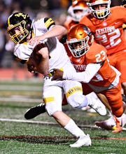 Red Lion's Tyler Ness (left) hopes to lead the Lions to a first-round win over Wilson in the District 3 Class 6-A playoffs. DISPATCH FILE PHOTO