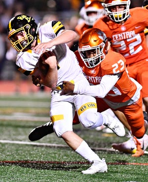 Red Lion's Tyler Ness, left, drags Central York's Judah Tomb into the end zone as he scores a touchdown during football action at Central York High School in Springettsbury Township, Thursday, Sept. 14, 2018. Red Lion would win the game 56-28. Dawn J. Sagert photo