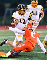Red Lion's Zach Mentzer, left, gains some yardage while Central York's Darnell Johnson defends in a game earlier this season. Red Lion takes on Northeastern this week. Dawn J. Sagert photo