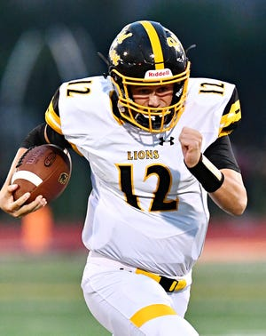 Red Lion's Zach Mentzer gains some yardage during football action against Central York at Central York High School in Springettsbury Township, Friday, Sept. 14, 2018. Red Lion would win the game 56-28. Dawn J. Sagert photo