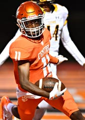 Central York's Taylor Wright-Rawls scores a touchdown during football action against Red Lion.