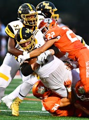 Red Lion's Elijah Workinger gets taken down by Central York. Dawn J. Sagert photo