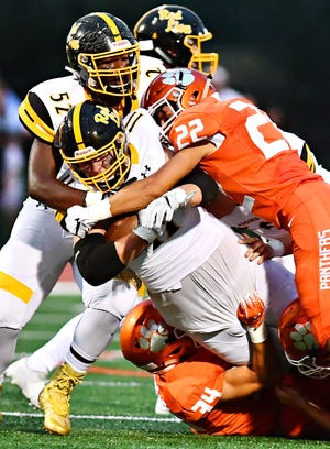Red Lion's Elijah Workinger, shown here being tackled, committed to play tight end at Millersville University on Monday. DISPATCH FILE PHOTO