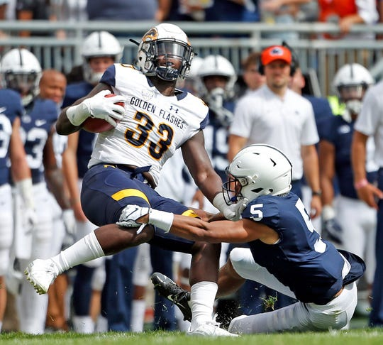 Penn State's Tariq Castro-Fields (5) tackles Kent State's Jo-El Shaw (33) during the second half of an NCAA college football game in State College, Pa., Saturday, Sept. 15, 2018. Penn State won 63-10.