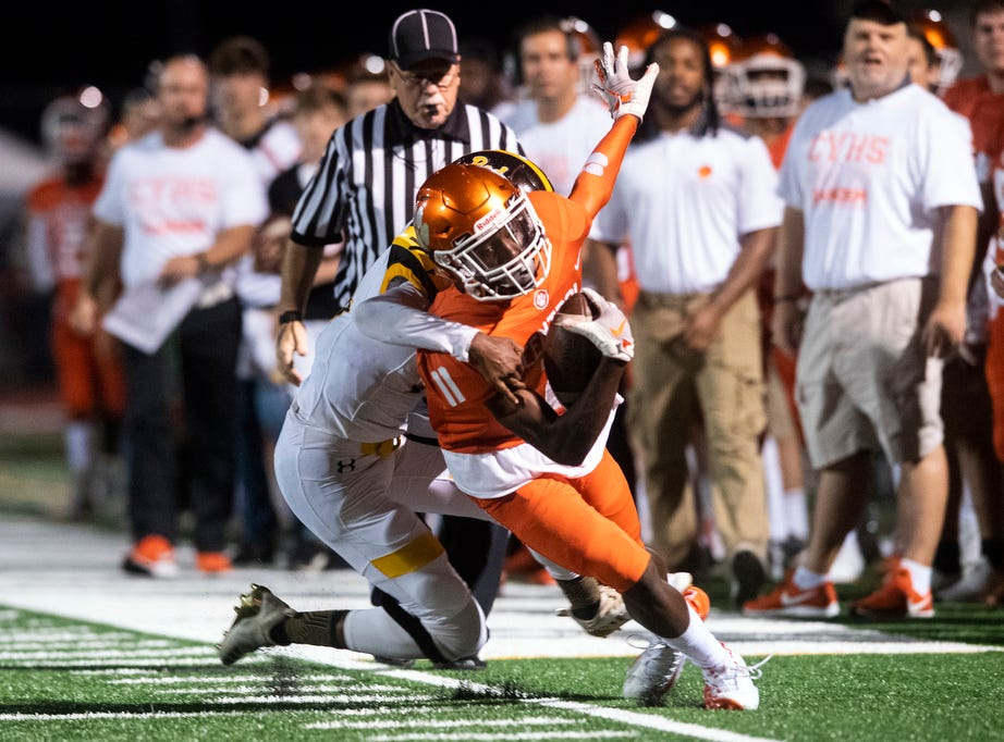 Central York's Taylor Wright Rawls (11)  tries to stay in bounds after completing a catch during a game at Central York on Friday, September 14, 2018. The Red Lion Lions beat the Central York Panthers, 42-21.
