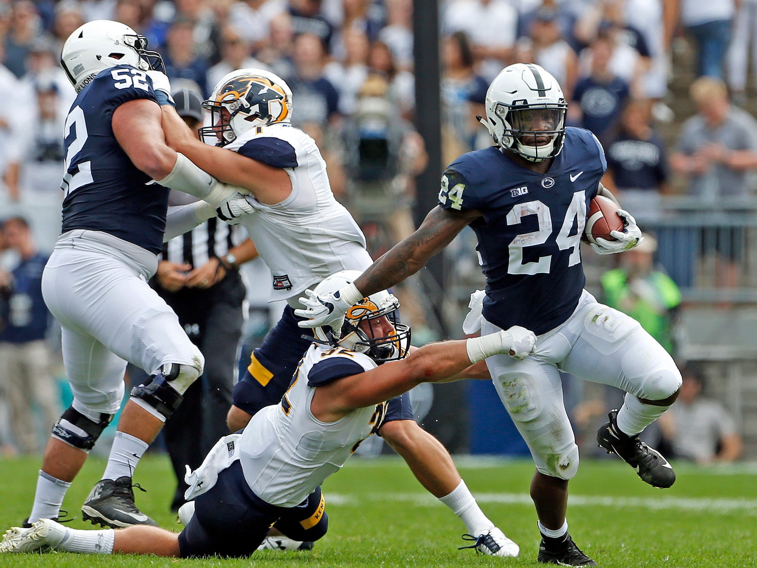 Penn State's Miles Sanders (24) gets past Kent State's Dalton Hicks (32) during the first half of an NCAA college football game in State College, Pa., Saturday, Sept. 15, 2018.