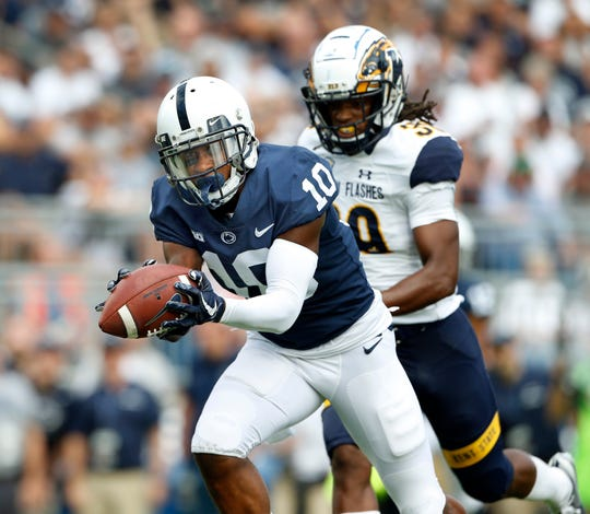 Penn State's Brandon Polk (10) catches a touchdown pass in front of Kent State's Miles Daniel (39) during the second half of an NCAA college football game in State College, Pa., Saturday, Sept. 15, 2018. Penn State won 63-10.