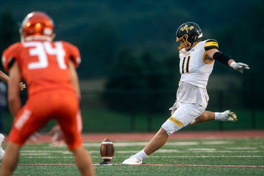 Red Lion's Elijah Workinger (11) kicks the ball off for the Lions during a game at Central York on Friday, September 14, 2018. The Red Lion Lions beat the Central York Panthers, 56-28.