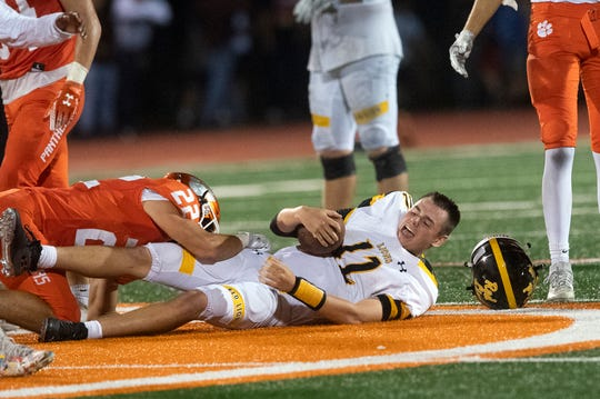 Red Lion quarterback Zach Mentzer's (12) helmet comes off as Central York tackles him during a game at Central York on Friday, September 14, 2018. The Red Lion Lions beat the Central York Panthers, 56-28.