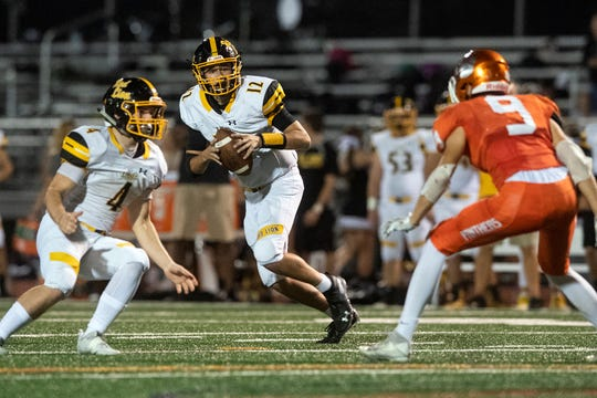 Red Lion quarterback Zach Mentzer (12) drops back to look for a pass during a game at Central York on Friday, September 14, 2018. The Red Lion Lions beat the Central York Panthers, 42-21.