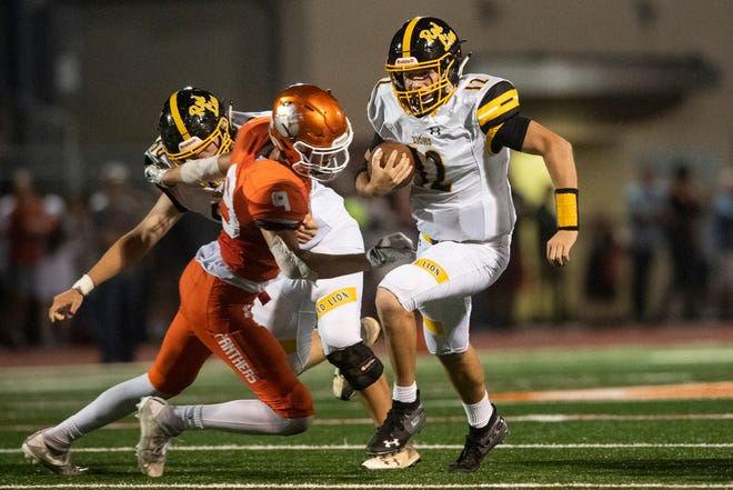 Red Lion quarterback Zach Mentor (12) runs the ball up the field for a first down, during a game at Central York on Friday, September 14, 2018. The Red Lion Lions beat the Central York Panthers, 42-21.