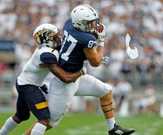 Penn State's Pat Freiermuth (87) catches a pass in front of Kent State's Jamal Parker (7) during the second half of an NCAA college football game in State College, Pa., Saturday, Sept. 15, 2018. Penn State won 63-10.