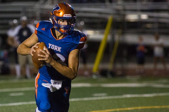 York High quarterback Seth Bernstein looks to pass before running into the end zone to convert a two-point conversion. York High defeats New Oxford 71-14 in football at Small Athletic Field in York, Friday, September 14, 2018.