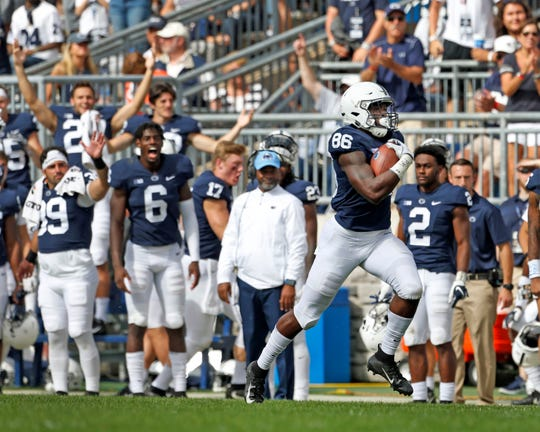 Penn State's Daniel George (86) catches a pass and takes it 95 yards for a touchdown against Kent State during the second half of an NCAA college football game in State College, Pa., Saturday, Sept. 15, 2018. Penn State won 63-10.
