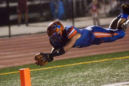York High's Dayjure Stewart dives into the end zone for his final touchdown of the game. York High defeats New Oxford 71-14 in football at Small Athletic Field in York, Friday, September 14, 2018.